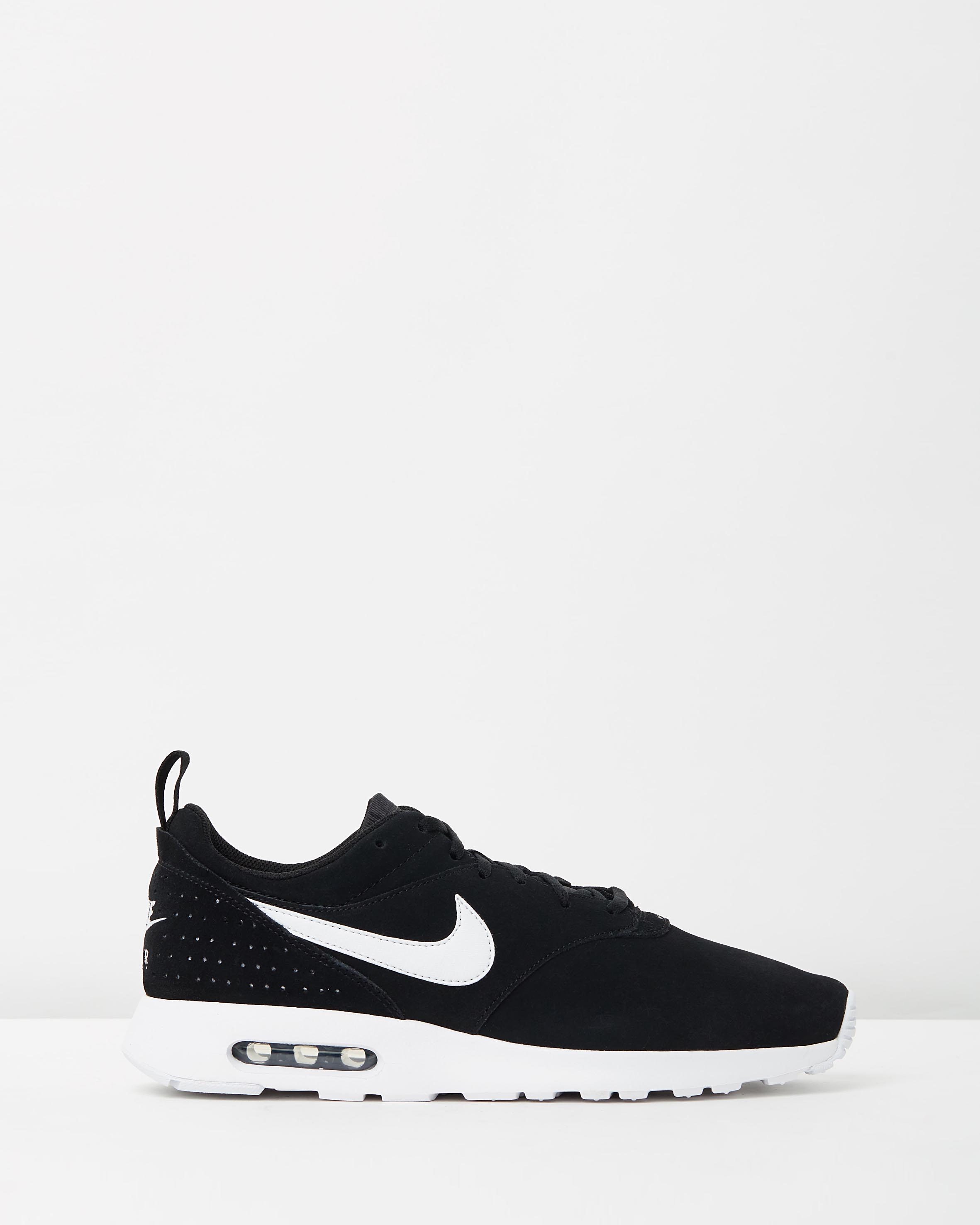 nike men s air max tavas leather black white sneaker. Black Bedroom Furniture Sets. Home Design Ideas