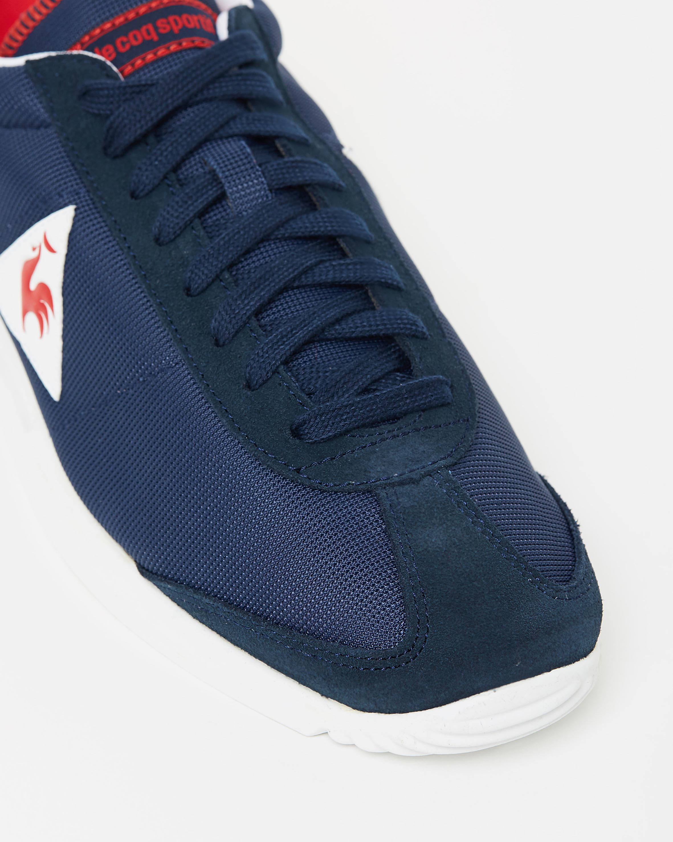 le coq sportif quartz nylon sneakers in dress blue sneaker store. Black Bedroom Furniture Sets. Home Design Ideas